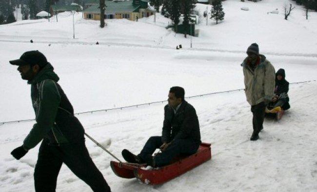 Tourists enjoying sledge ride at the world famous ski resort...