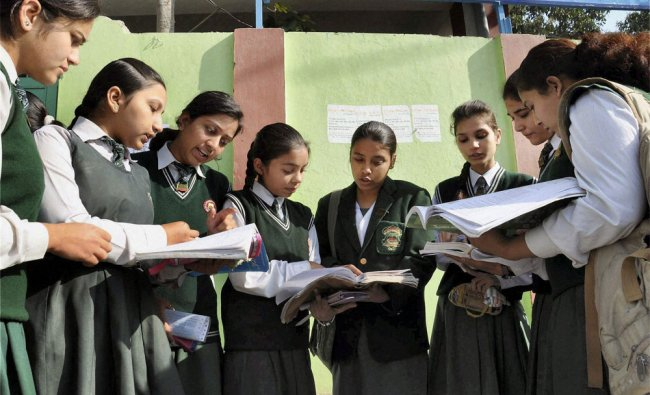 12th standard students giving a last look to their notes