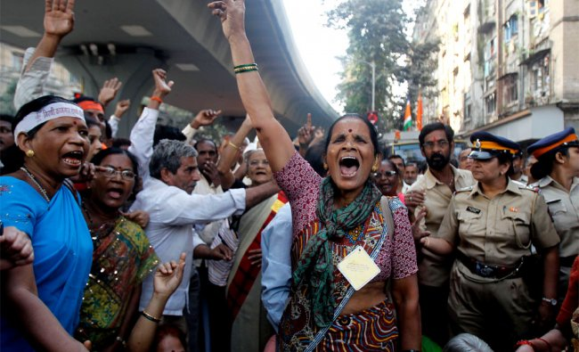 Former mill workers shout slogans during a protest in Mumbai