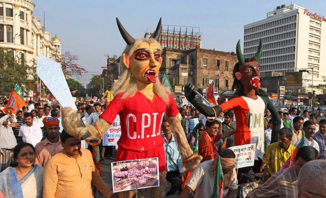 Activist of BJP take part in a rally against TMC-CPI(M)