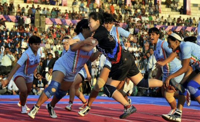 Indian eves in action against Korean players in the Women\'s World Cup Kabaddi Championship