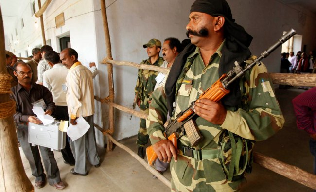 A security officer stands guard outside a counting centre in Lucknow
