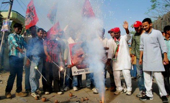 Samajwadi Party workers celebrate the success...