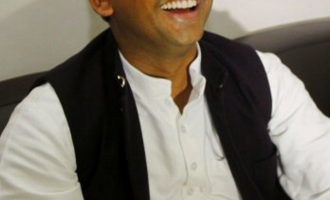 Akhilesh Yadav, general secretary of Samajwadi Party, , smiles at the party office in Lucknow...