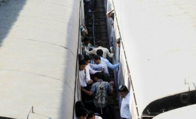Commuters risk their lives while boarding local trains in Mumbai...