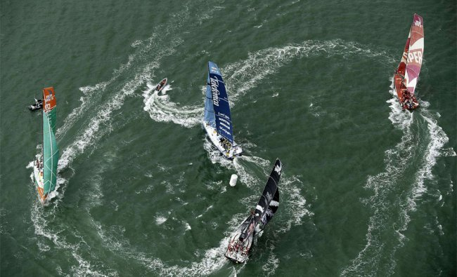Participants in the Volvo Ocean Race 2011-12 round a mark