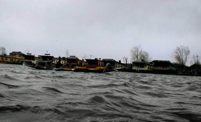 A view of the troubled water of the world famous Dal Lake during strong winds in Srinagar