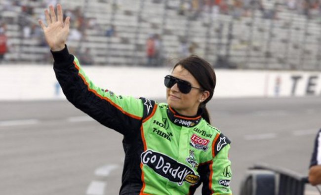 IndyCar driver Danica Patrick waves to fans during the Texas Firestone Twin 275 auto races in Texas