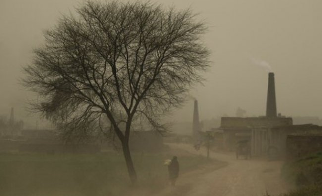 A Pakistani villager walks during a dust storm in the suburbs of Islamabad, Pakistan