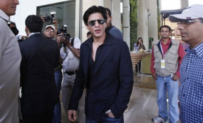 Shah Rukh Khan, center, arrives to attend the Indian Premier League player auction in Bangalore