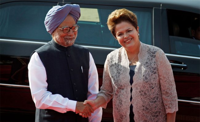Brazilian President Dilma Rousseff shakes hand with Prime Minister Manmohan Singh