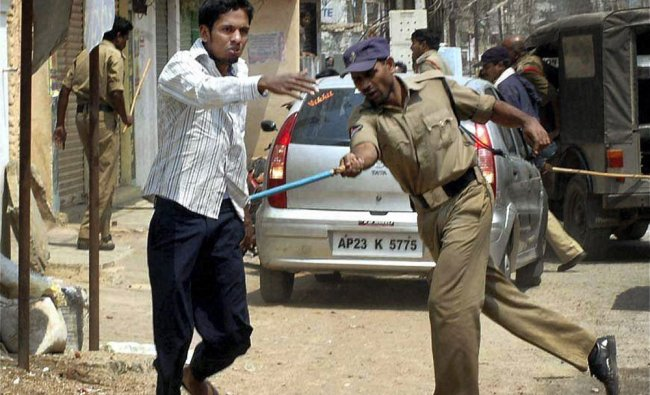 Police disbursing the youths after the communal riots at Sangareddy district of Andhra Pradesh