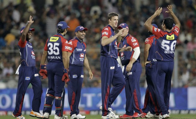 Morne Morkel, fourth left, celebrates with teammates after taking a wicket