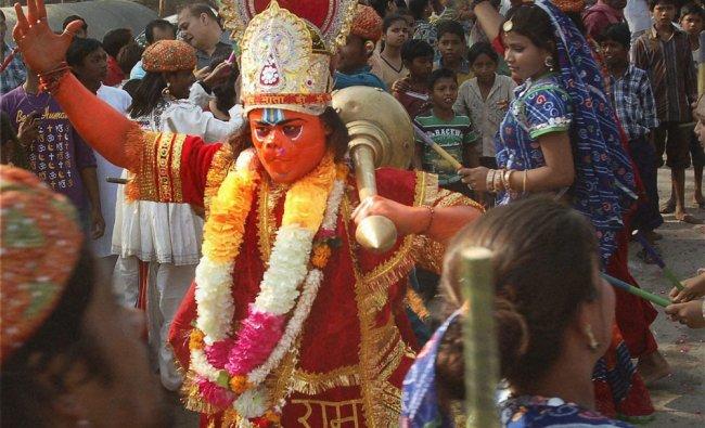 A devotee, dressedv as Lord Hanuman, take part in a Shobha Yatra on the occasion of Hanuman Jayanti
