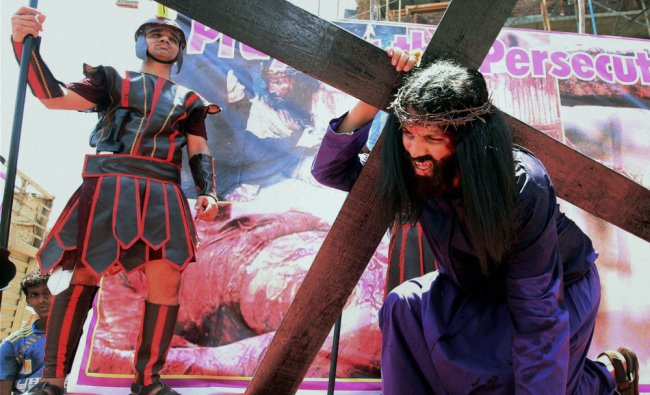 Christian devotees enact the crucifixion of Jesus on the occasion of Good Friday in Mumbai