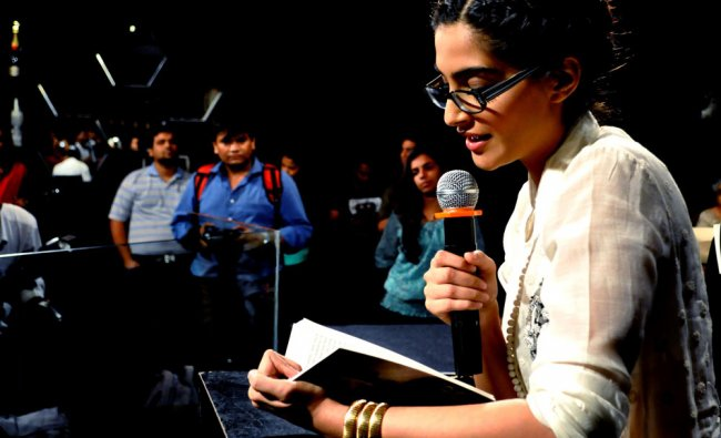 Sonam Kapoor reads during the unveiling of Khalid Mohamed\'s book \'Two Mothers\' in Mumbai
