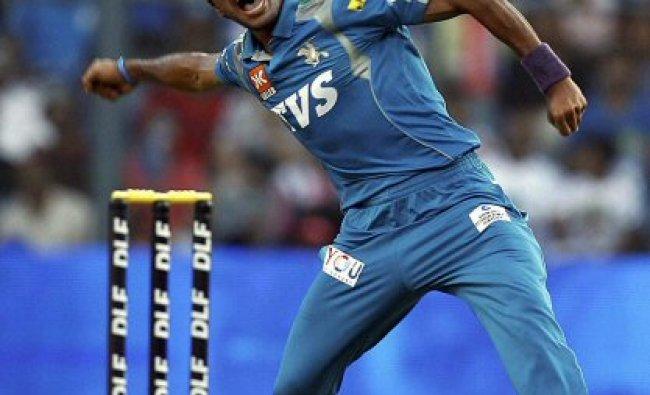 Pune Warriors bowler Ashok Dinda celebrates the wicket of