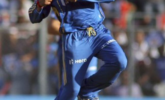 Mumbai Indians\' cricketer Harbhajan Singh celebrates the dismissal...