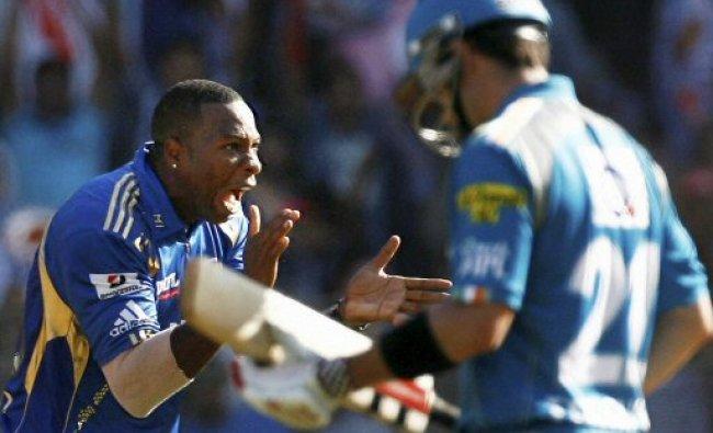 Mumbai Indians bowler K Pollard (L) celebrates the wicket...
