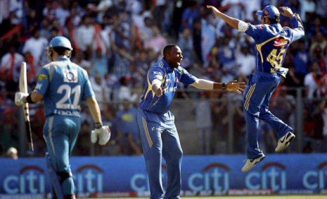 Mumbai Indians bowler K Pollard (C) celebrates...