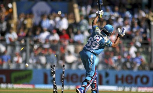 The bails fly off the wickets to dismiss Pune Warriors Manish Pandey...