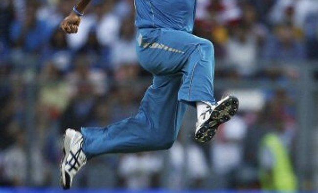 Mumbai: Pune Warriors bowler Ashok Dinda celebrates the wicket...