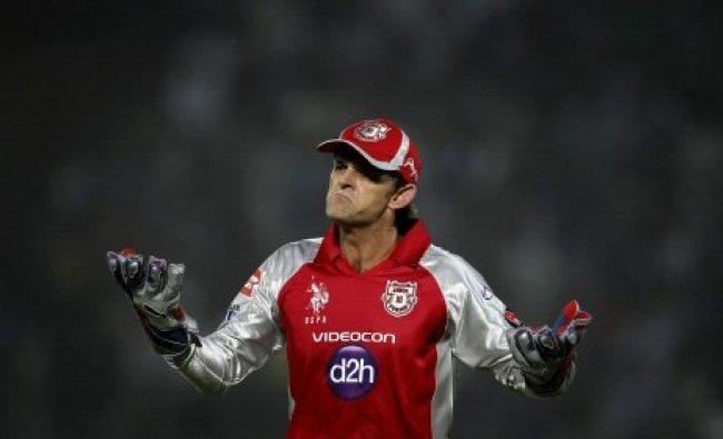 Kings XI Punjab\'s Adam Gilchrist reacts to his bowler James Faulkner...