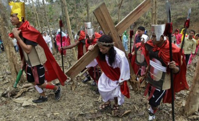 A devotee enacts the crucifixion of Jesus Christ...