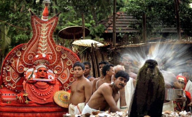 Devotees perform Thengayeru as part of Palottu Kavu temple festival in Kannur