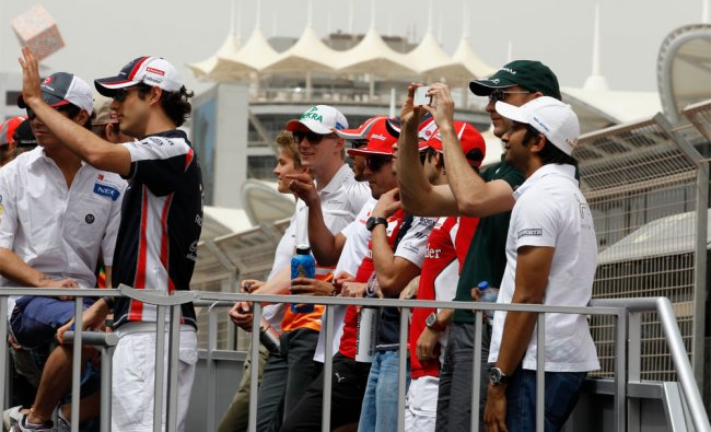 F1 drivers after their ride on a truck during driver\'s parade before start of Bahrain F1 Grand Prix