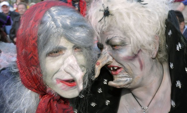 Women dressed as witches dance during the Walpurgis Night at the famous Hexentanzplatz