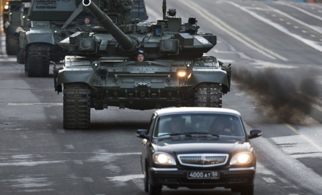 Russian tanks make their way down a road during a rehearsal for the Victory Day military parade