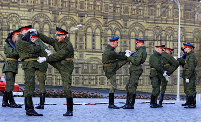 Russian honor guard soldiers stretch during a rehearsal for the Victory Day military parade