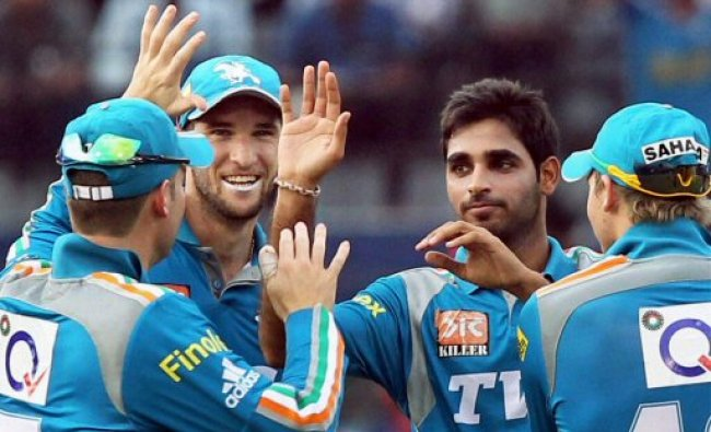Pune Warriors players celebrate the dismissal of Deccan Chargers\' Shikhar Dhawan...