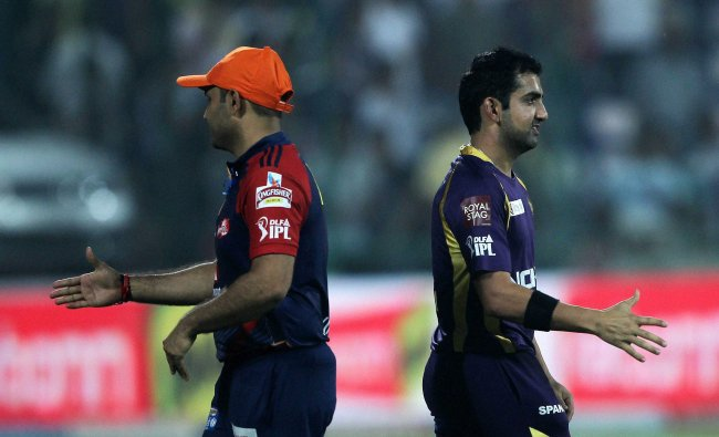 Delhi Daredevils\' Virender Sehwag and Kolkata Knight Riders\' Gautam Gambhir after their match...