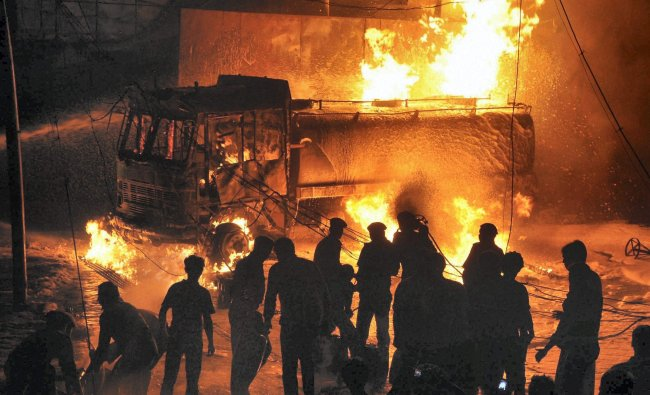 Fire fighters trying to extinguish fire at a petrol pump in Ranchi