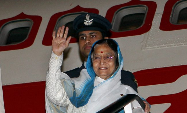 President Pratibha Devisingh waves as she prepares to depart for Delhi...