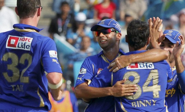 Rajasthan Royals players celebrate the dismissal of Pune Warriors batsman Michael Clarke