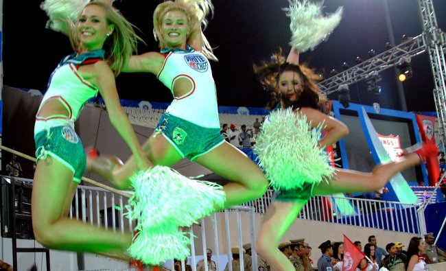 Cheer leaders perform at the start of the IPL 5 match between Deccan Chargers and Kings XI Punjab