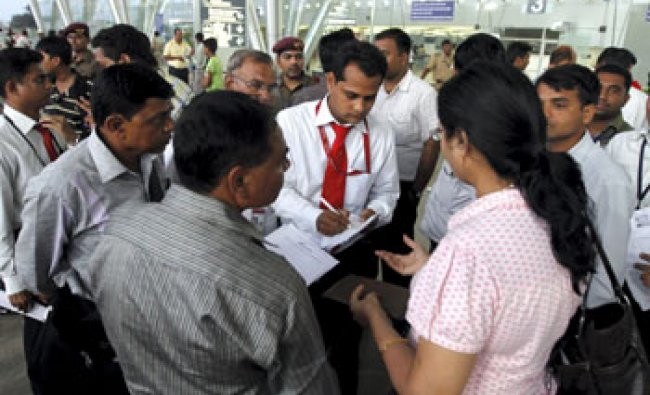 Stranded passengers of Air India at Ahmedabad airport after their flight was canceled on Tuesday...