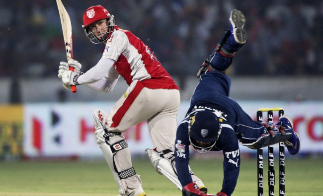 Deccan Chargers wicket keeper Parthiv Patel, foreground, dives as he tries to stop the ball as...