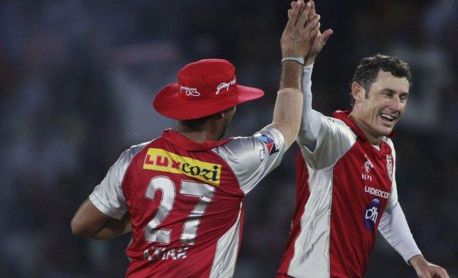 Kings XI Punjab bowler David Hussey, right, with Azhar Mahmood, celebrates the wicket of Deccan...