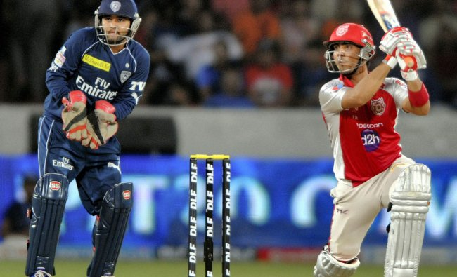 Kings XI Punjabs Mandeep Singh drives en route to his 75 against Deccan Chargers
