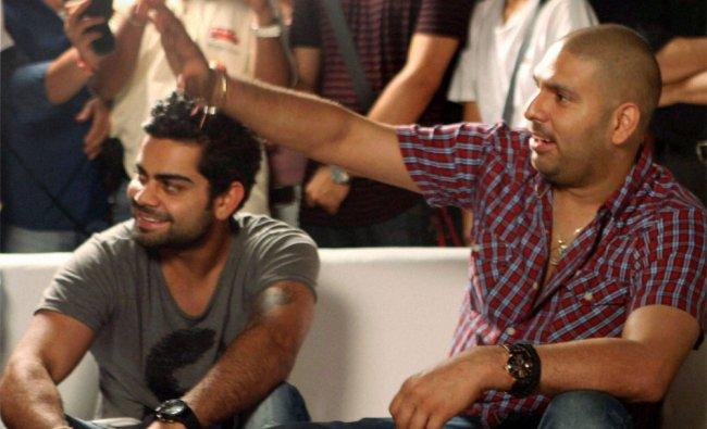 Cricketers Yuvraj Singh and Virat Kohli at an event in Mumbai