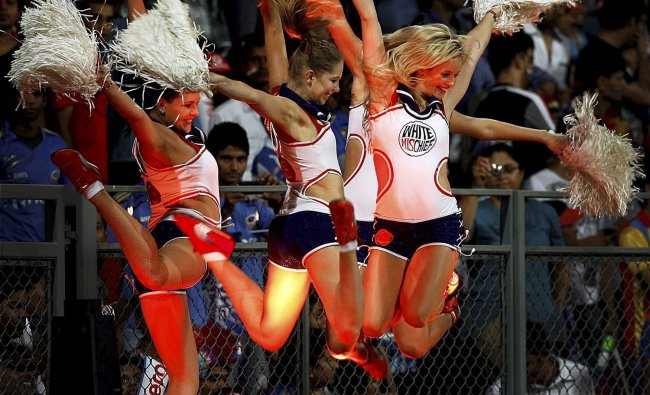 Royal Challengers Bangalore\'s cheer leaders perform during the match played between Mumbai...