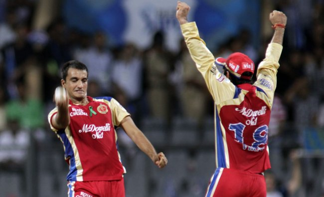Royal Challengers Banglore\'s Harshal Patel, left, celebrates Mumbai Indians Sachin Tendulkar\'s...