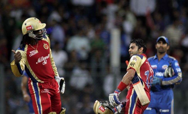 Royal Challengers Banglore\'s Chris Gayle, left, and Virat Kohli celebrate their win over Mumbai...