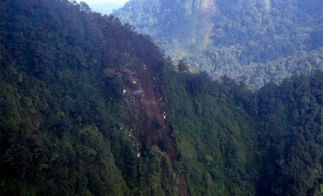 The wreckage of a missing Sukhoi Superjet-100 are scattered on the mountainside in Bogor