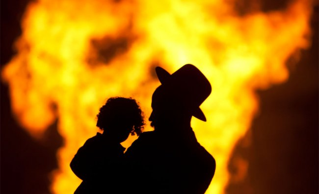 Ultra-Orthodox Jews stand next to bonfires during Lag Ba\'Omer celebrations in Israel