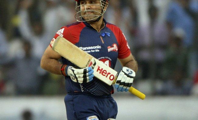 Delhi Daredevils\' Virender Sehwag walks back after being dismissed by Deccan Chargers\' bowler...